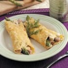 Asparagus Chicken Crepes - With a saucy ham and asparagus filling, these savory crepes make a lovely dinner. They're a wonderful change of pace from everyday fare.