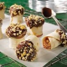 Chocolate-dipped and Candy-coated Pinwheel - Creamy chocolate and caramel and bits of peanut brittle are rolled into tortillas, then cut into pieces and dipped in chocolate and more crunchy peanut brittle bits for a sweet and tasty snack.
