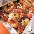 Perfect Garlic and Parmesan Potatoes - Red potatoes seasoned with rosemary and garlic are cooked in a sealed foil packet and served with grated Parmesan cheese for an easy and delicious side dish.