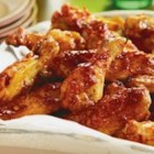 Sweet and Spicy Chicken Wings - Sweet honey and spicy picante sauce combine to make an irresistible glaze for the crispy chicken wings in this easy to make appetizer.  Make plenty...these won't last long!