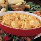 Chicken N Biscuits - 'This cheesy chicken casserole gets its vibrant color from frozen vegetables and its unique flavor from crumbled bacon,' reports Debbie Vannette of Zeeland, Michigan. 'The biscuit-topped dish has become a regular at our dinner table since my sister-in-law shared it with us after the birth of our son.'