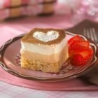 Ti Amo Tiramisu Treats(TM) - Layers of vanilla- and espresso-flavored cream top crispy little cakes in this lovey-dovey dessert.