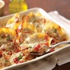 Creamy Pesto-Stuffed Shells - Jumbo pasta shells are stuffed with creamy pesto, browned beef, and cheese mixture then baked with your favorite spaghetti sauce--easy and delicious!