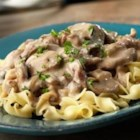 Slow Cooker Creamy Beef Stroganoff - Beef bottom round steak slow cooks to tenderness in a creamy mushroom sauce that the whole family will love!