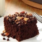 Chocolate-Chipper Cake - Pears are blended into the batter of this rich chocolate sheet cake that's topped when still warm with chocolate chips and chopped pecans.