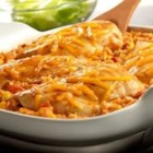 Tex-Mex Chicken and Rice Bake - This simply delicious and festive dish features Campbell'(R) Condensed Cream of Chicken Soup mixed with salsa, corn and rice, topped with chicken breasts, a dash of paprika and melted Cheddar cheese.