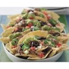Cheesy Beef Nachos - Whip up restaurant style beef nachos in no time with the help of your microwave.