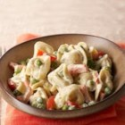 Tortellini Italiano - Dinner's on the table in no time with prepared cheese tortellini served in a creamy, Italian-seasoned sauce with red bell peppers and peas.