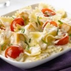 Creamy Chicken-Bruschetta Pasta - Topped with fresh basil and ready to serve in less than 30 minutes, this one-dish dinner features chunks of browned chicken and grape tomatoes simmered in a creamy garlic sauce with farfalle pasta.