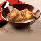 Sweet Apple-Cinnamon Baked Oatmeal - Rolled oats, apple pie filling, and cinnamon are blended with an egg-milk mixture, then baked for an easy breakfast or brunch dish.