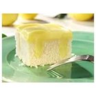Lemon Pudding Poke Cake - Lemon lovers will request this sweet and tangy poke cake again and again.