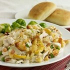 Tasty Turkey Tetrazzini - Creamy, cheesy and loaded with turkey and veggies, this turkey tetrazzini with egg noodles will please the heartiest of appetites.