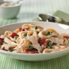 Quick Pasta Carbonara - The rich flavors of bacon and green peas combine with a cheesy, creamy sauce to serve with hot, cooked pasta.