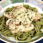 Salmon With Green Fettuccine - The red flesh of the salmon contrasts with the dark green pasta to make a gorgeous dish.  It is served with a dill flavored white sauce. This recipe makes 3 generous portions or 6 smaller servings.