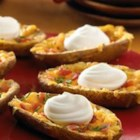 Daisy Brand Potato Skins - Make your own baked potato skins--these are buttery, cheesy, filled with bacon, and topped with a dollop of Daisy and a sprinkle of chives!