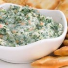 Tuscany Harvest Dip - A layered dip with white beans, arugula, and all the flavors of Tuscany.