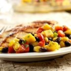Salsa Verde Corn and Bean Salad - Red pepper, mango, corn and black beans are mixed with a zesty green salsa for this refreshing corn and bean salad.