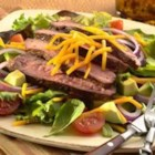 Grilled Pepper Steak Salad - Steak, Reduced Sodium Mild Cheddar and salad work together perfectly in one bowl topped with a delicious, simple homemade dressing.
