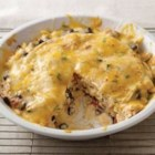 Santa Fe Chicken Casserole - Layers of tortillas, melty cheese and chicken combine with Santa Fe-inspired cooking creme, sending your taste buds on a quick trip down Route 66.