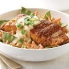 Creamy Vegetable Rice with Teriyaki Salmon - Salmon fillets are seared in a skillet and served over rice with carrots and snows peas in a creamy teriyaki-garlic sauce.