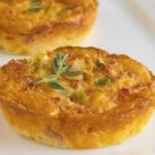 Crustless Cheddar and Sun-Dried Tomato Mini Quiches - A great portable meal option that offers bursts of flavor from sun-dried tomatoes, reduced-fat Cheddar cheese and herbs.  Cheddar is an aged, natural cheese that contains a small amount of lactose, making this recipe a friendly option for those who are lactose intolerant.