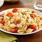 Shells with Cherry Tomatoes, Basil and Parmigiano-Reggiano Cheese - The simplicity of Italian flavors like basil and cherry tomato comes through in this healthy, easy pasta dish.  Barilla White Fiber pasta adds a boost of fiber but looks and taste like your regular pasta.