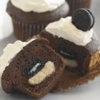 Mini OREO Surprise Cupcakes - We love cupcakes – and surprises. Each of these chocolate cupcakes comes with a hidden cookie surprise. But, shh... you didn't hear it from us.