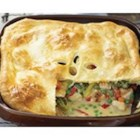 Gram's Chicken Pot Pie Updated - Comfort food at its finest--this chicken pot pie with a puff pastry crust is full of vegetables, chunks of chicken and shredded Cheddar cheese; and it's on the table in no time.