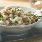Italian Chicken Sausage Risotto  - Sweet Italian chicken sausage, sweet onions, garlic and thyme are sauteed together as the savory base for this creamy risotto dish.