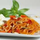 Farfalle with Roasted Red Pepper and Pine Nuts Served with Ricotta and Fresh Mozzarella - You'll love the bright colors and variety of textures in this delicious pasta dish. Barilla Veggie pasta is made with squash and carrots for an additional veggie boost