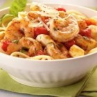 Italian Shrimp Caprese Pasta - This colorful pasta dish is full of flavor and can be made in less than 30 minutes.