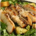 Smoked Chicken Caesar Salad with Maille(R) Dijon Originale Mustard - Homemade Caesar salad dressing--rich with egg, anchovy, garlic, and Dijon mustard--elevates this salad from a simple side to a stunning main dish when topped with slices of smoked chicken breast.