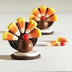 OREO Turkey - These festive OREO Turkeys are so cute – you won't want to wait until Thanksgiving to make them! Even the littlest helpers will love attaching candy corn feathers to the turkeys' cookie tails.