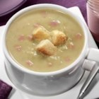 Creamy Pea Soup from National Dairy Council - This filling, hearty winter soup is blended with peas and diced ham to warm any chilly night and is made with nutrient-rich fat-free or low-fat lactose-free milk.