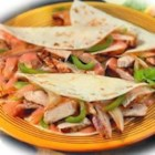 Tyson(R) Monterey Chicken Fajitas - Make a quick and easy fajita dinner tonight using fully cooked grilled chicken breast fillets, bell pepper, onion, and Monterey Jack cheese.
