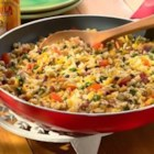 Hoppin' John Skillet - Mix black-eyed peas, rice, bacon and hot sauce with Sargento Shredded Reduced Sodium Mild Cheddar for a delicious treat.