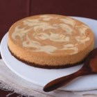 Pumpkin Swirl Cheesecake - Gingersnaps and pecans form the crust of this fabulous fall cheesecake. Plain and pumpkin batters are swirled together for a pretty marbled effect.