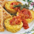 Mini Frittatas - For a fun change-of-pace breakfast, Kathy Brodin of Wauwatosa, Wisconsin suggests these sausage and hash brown frittatas perked up with salsa. 'To lower the cholesterol even more, use egg substitute for the whole eggs,' she notes.