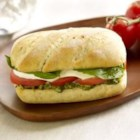 Tomato Basil Mozzarella Melt - Mini baguettes spread with pesto are filled with tomato and mozzarella slices, then heated until warm and cheese is melted.