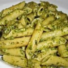 Penne With Garlic Pesto - Vegetable stock gives this pesto a special taste twist. It 's simmered in garlic before it joins the other ingredients - pine nuts, basil and Parmesan  - in the food processor. Stir into the pasta of your choice and enjoy.