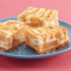 Apple Cheesecake Bars with Sea Salt Caramel Sauce - Bake up a pan of these crowd-pleasing apple cheesecake bars--the sea salt and caramel topping makes them irresistible.