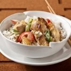 Thai Curry Chicken and Rice - Chunks of chicken breast and sliced onions are sauteed in flavorful Thai green curry paste, then cooked in a creamy sauce made with cream cheese and sliced red and green bell peppers. Serve over hot cooked rice.