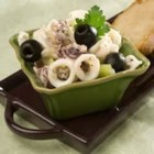 Grammy's Calamari Salad - Sliced squid is tossed with a lemon juice, garlic, and celery mixture!