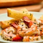 Shrimp Scampi with Garlic Bread - This scampi is just as good as you'll find in a restaurant.  The shrimp are flavored with a lemon-garlic marinade and served with slices of crusty garlic bread for mopping up the sauce.