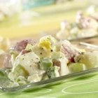 Crunchy Potato Salad - This all-American picnic favorite is made perfect with tender potatoes, green pepper, onion and hard cooked eggs in a creamy celery, vinegar and mayonnaise dressing.