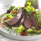 Beef Salad with Ginger Soy Dressing - Fill your plate with colorful veggies and greens, topped with lean sliced beef. Add a gingery soy dressing and this delicious salad will become a family favorite.