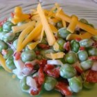 Bacon Ranch Pea Salad - Peas, bacon, cheese, onions, and Ranch dressing are tossed together and chilled in this great summer salad.