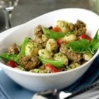 Creamy Pesto Gnocchi with Italian Sausage - A creamy pesto and Italian sausage sauce bring layers of flavor to gnocchi.