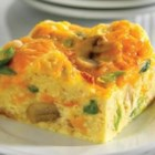Cheddar and Mushroom Breakfast Squares - This egg dish is baked to perfection, swirled with melted reduced-fat Cheddar cheese and speckled with mushrooms. Cheddar is an aged, natural cheese that contains a minimal amount of lactose, making this recipe a friendly option for those who are lactose intolerant.