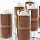Dark Chocolate Caramel Panna Cotta - Two layers of rich chocolate panna cotta with a layer of homemade caramel between are topped with whipped cream in this elegant dessert.